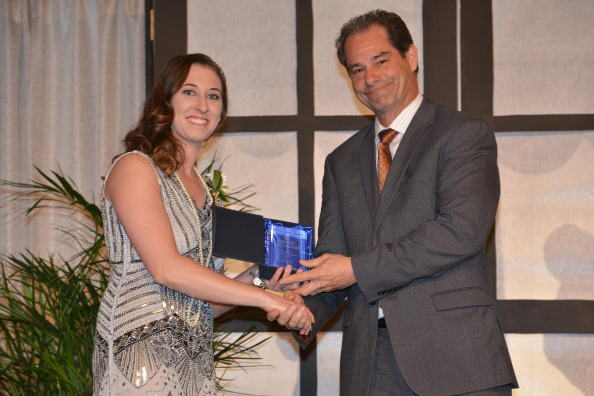 Dr. Wampler receives award during banquet