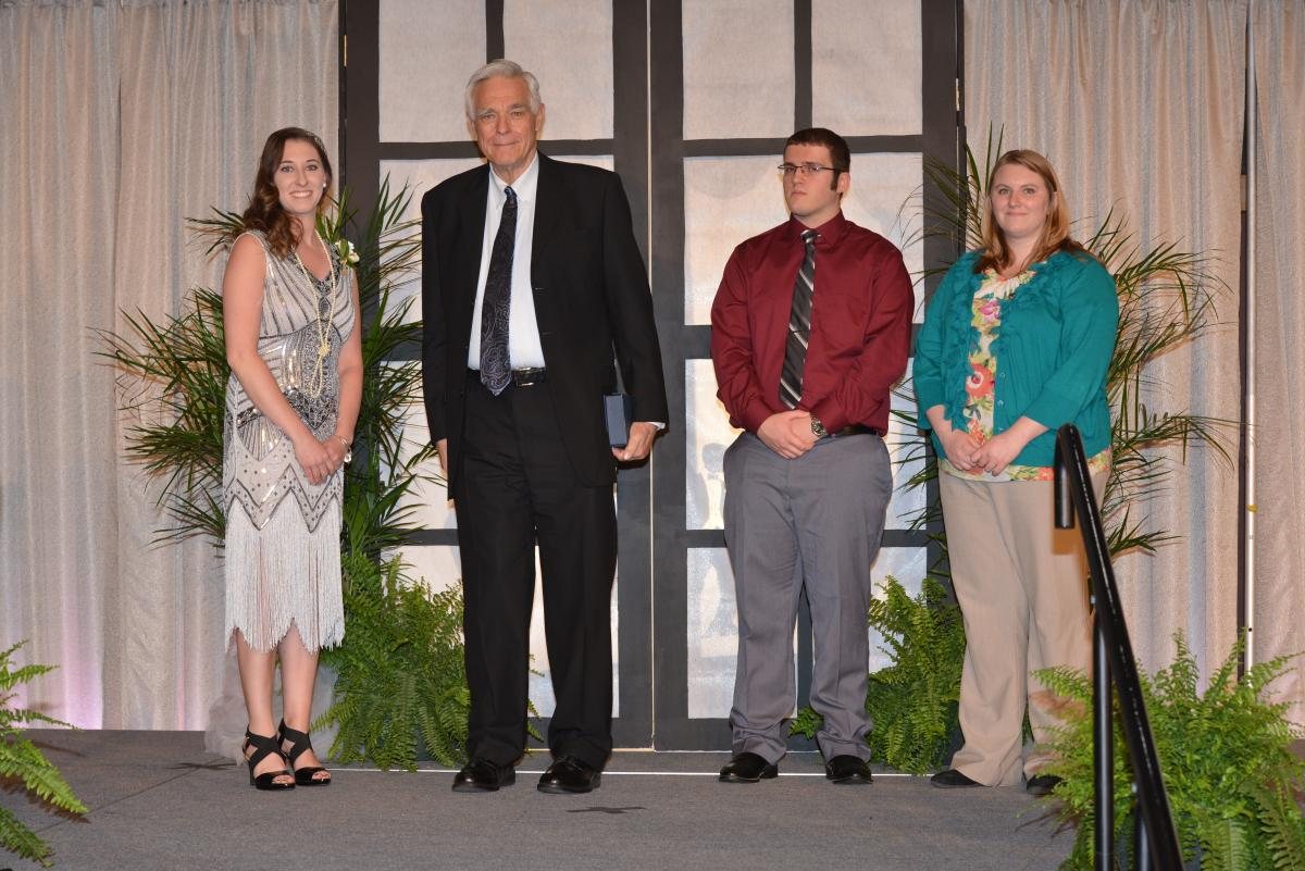 Mr. Noble receives award during banquet
