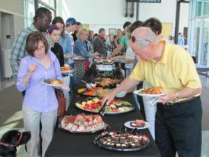 Graduates and guests enjoy the buffet