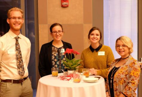https://advancement.cfaes.ohio-state.edu/Young%20alumni%20network%20around%20a%20table%20at%20an%20OSU%20sponsored%20event