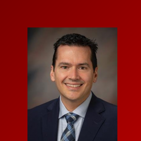 A red background with a professional headshot of David Darr is in the center.