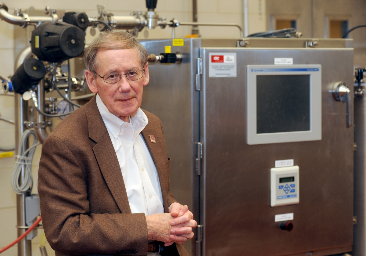 Dr. Heldman demonstrates CIP equipment.
