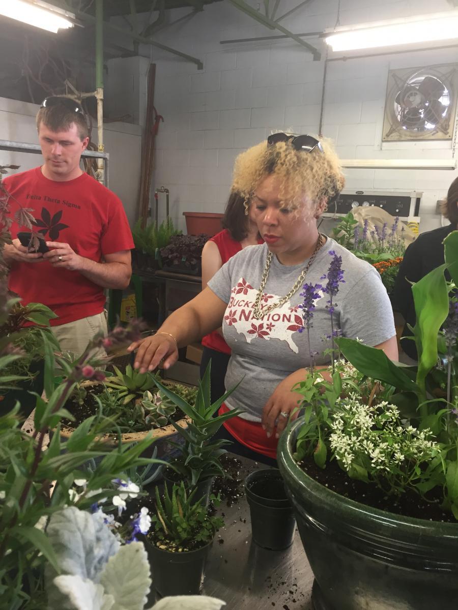 Alumni Society Board Members, Craig Miller & Yolanda Owens planting flowers at ATI.