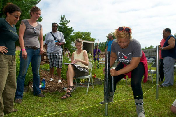 Owens works to build a community hoop house