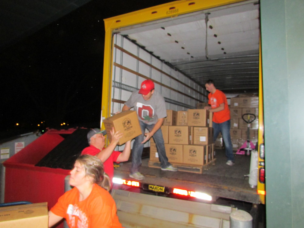 Stop Hunger Now volunteers load boxes of meals.