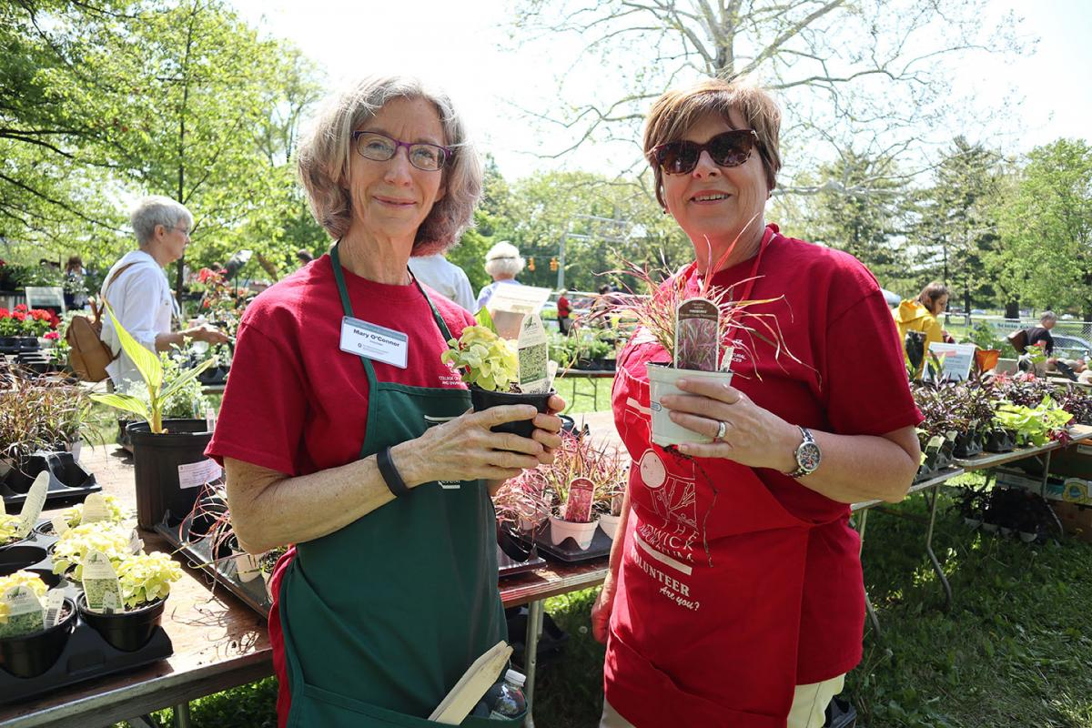 Volunteers holding plants