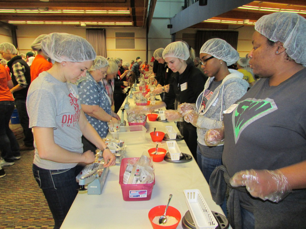 Stop Hunger Now volunteers prepare meals for shipping.