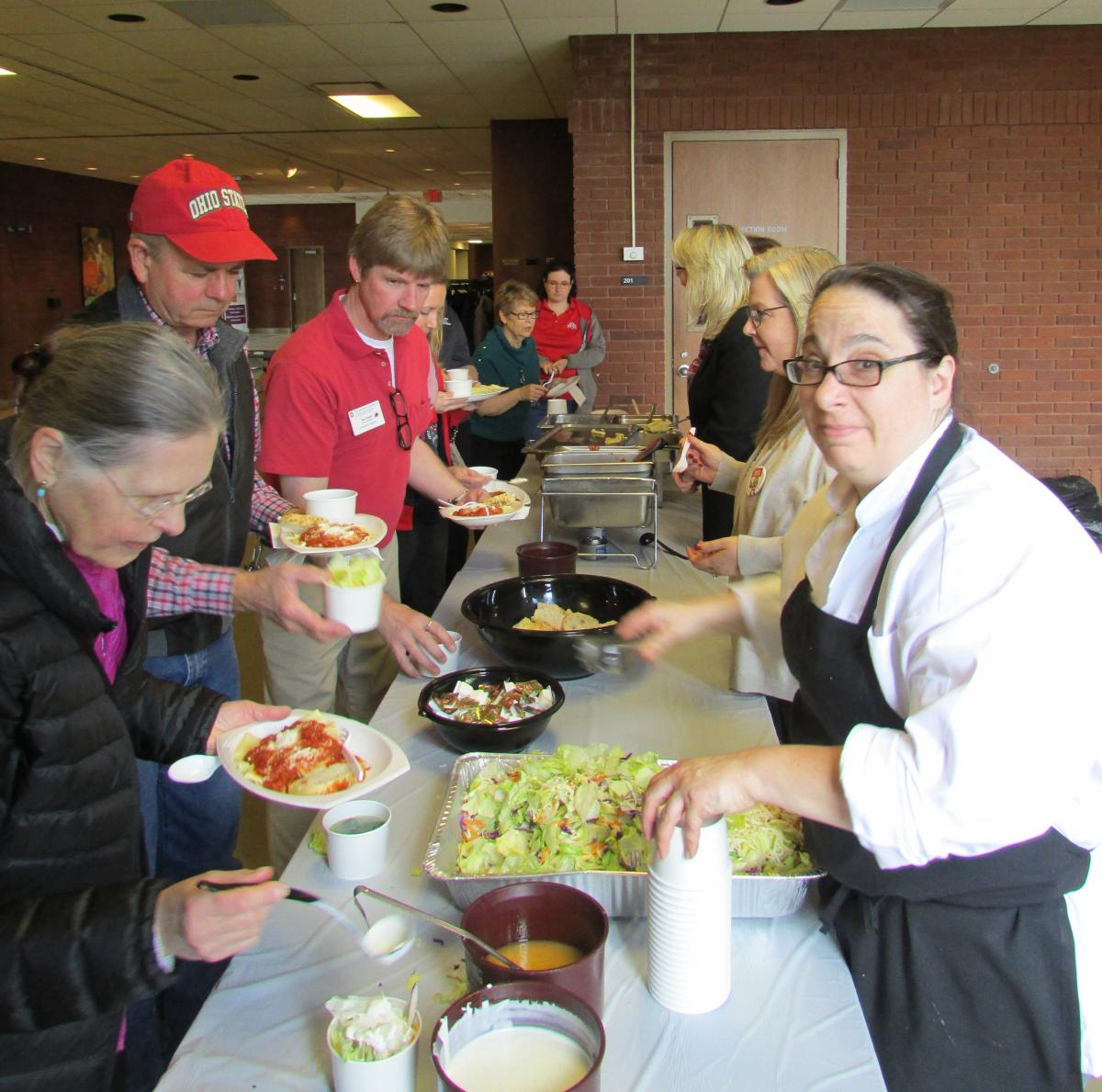 Staff lines up for Italian lunch at the Wooster event