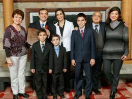 family of award winner posing for photo at awards banquet