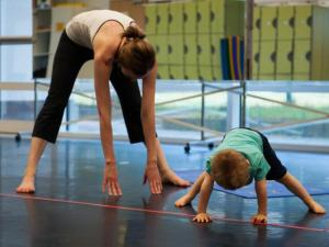 Mother and child practicing yoga.