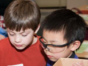 Two boys examining something.