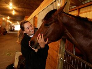 A student with a horse at ATI's Equine Center