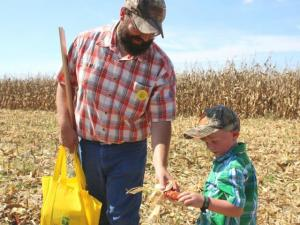 Father and son at Farm Science Review. Photo source: Farm and Dairy, Salem, Ohio.