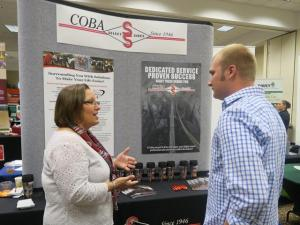 Employer talks to a student at a CFAES career event.