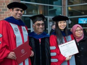 Dr. Bala Balasubramaniam with graduates and family
