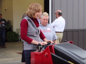 Dean Cathann A. Kress with a tractor