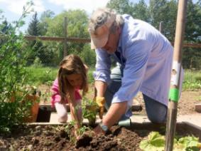 A man and child gardening