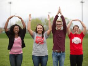Students making O-H-I-O sign