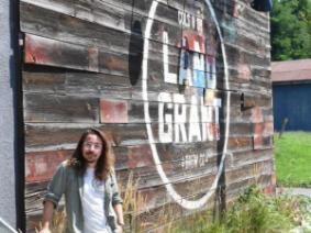 Sustainability manager Valentino outside of Land-Grant Brewery, located in the downtown Columbus community of Franklinton.