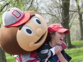 Brutus hugs an alum