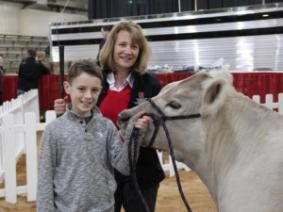 Dean Cathann Kress with 4-H Member Wyatt Osborn