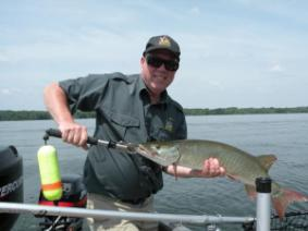 Kevin Kayle holding a Walleye