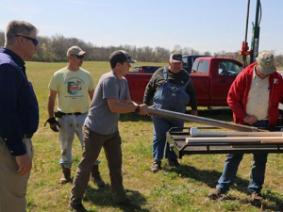 From left: Farmer Todd Mason, soil scientists Steve Baker and Matthew Tucker, farmer David Brandt and retired soil scientist George Derringer take soil bores at Ohio State Lima.