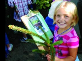 Child holding a plant