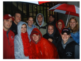 Students huddled together in the rain during Homecoming 2006