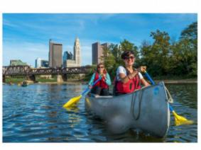 Students canoeing on the Scioto River near Downtown Columbus